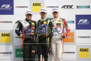 Joey Mawson alongside McLaren F1 Junior Driver Lando Norris and Mick Schumacher on the Rookie podium